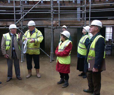 a public panel supervise the construction of a facility
